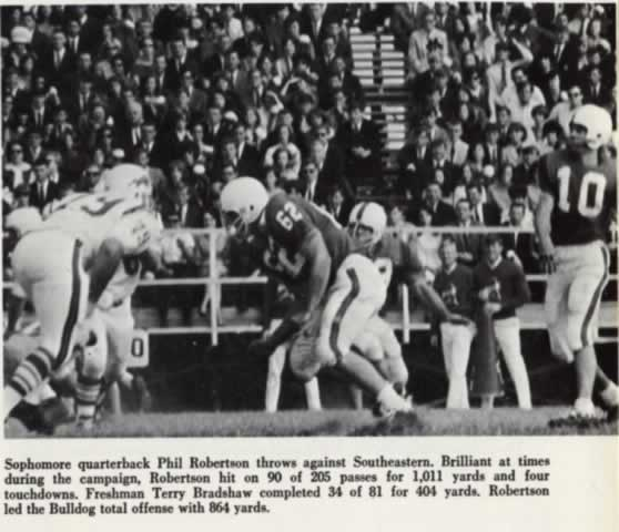 Photo of Louisiana Tech sophomore quarterback Phil Robertson throwing a pass in 1966